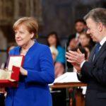 """Merkel recibe de Santos la """"Lámpara de la Paz"""" pendiente de Irán e Israel"""